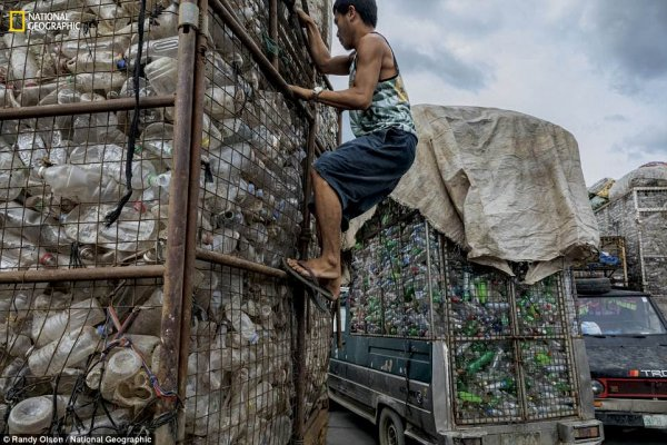 4c49c77800000578-5733223-trucks-full-of-plastic-bottles-pull-into-a-recycling-facility-in-a-25-1526419508239