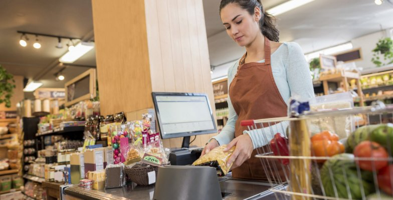 cashier-working-at-a-food-market-000094776725-large-e1495750635570
