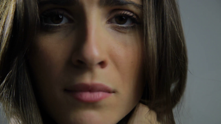 extreme-closeup-of-beautiful-sad-woman-looking-camera-portrait-vvyjbcmhx-f0014