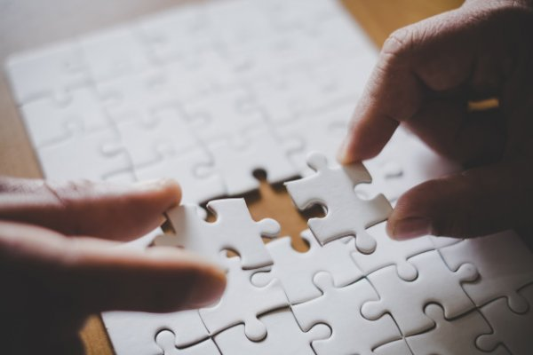 man-hands-connecting-couple-puzzle-piece-office-goals-strategy-2379-1381